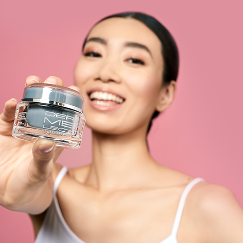 Model Holding Skincare Product